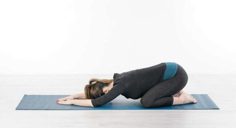 A image of woman doing Pilates exercise . we do pilates for beginners